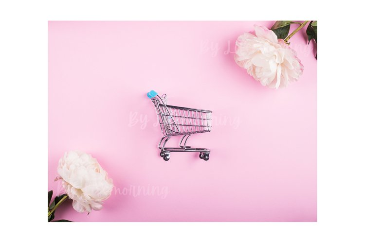 Shopping cart and peonies