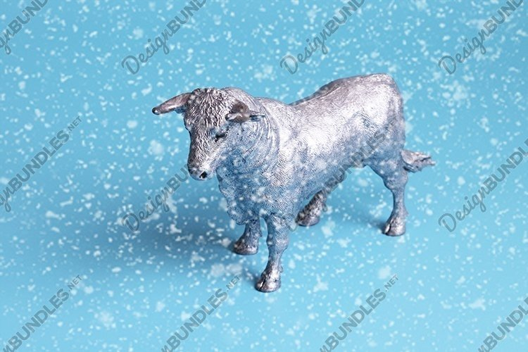 White Metal Bull is the Symbol of 2021 with snow example image 1