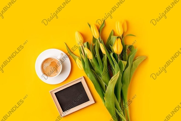 Coffee mug with bouquet of yellow tulips and mock up
