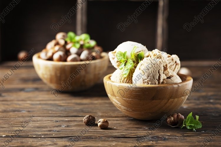 Delicious ice cream with hazelnut and mint, selective focus example image 1