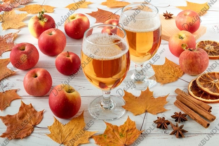 Ripe red apples, spices and glasses with cider example image 1