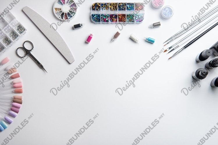Top view of manicure equipment on white background example image 1