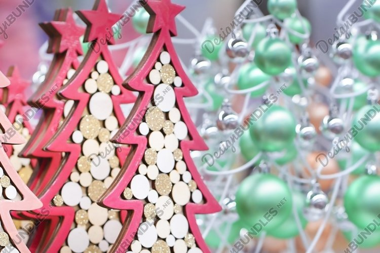 Blurred decorative figurines colorful christmas trees example image 1