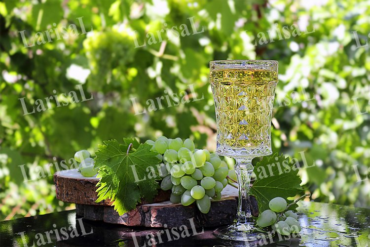 White grapes, crystal glass, young wine, abstract background