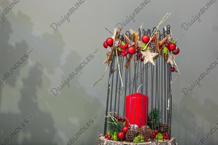 Christmas red candle on a stump decorated with cones fir example image 1