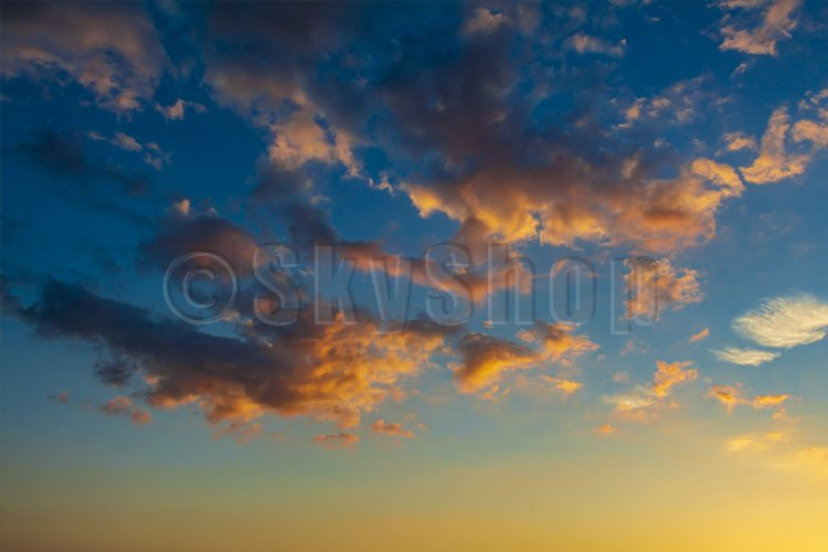 Magical clouds in the rays of the setting sun. example image 1