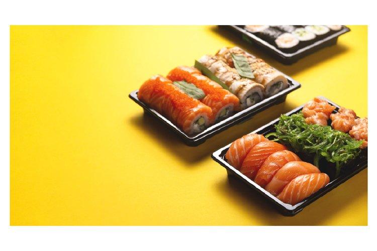 Bright beautiful sushi with fresh fish, caviar and chuka