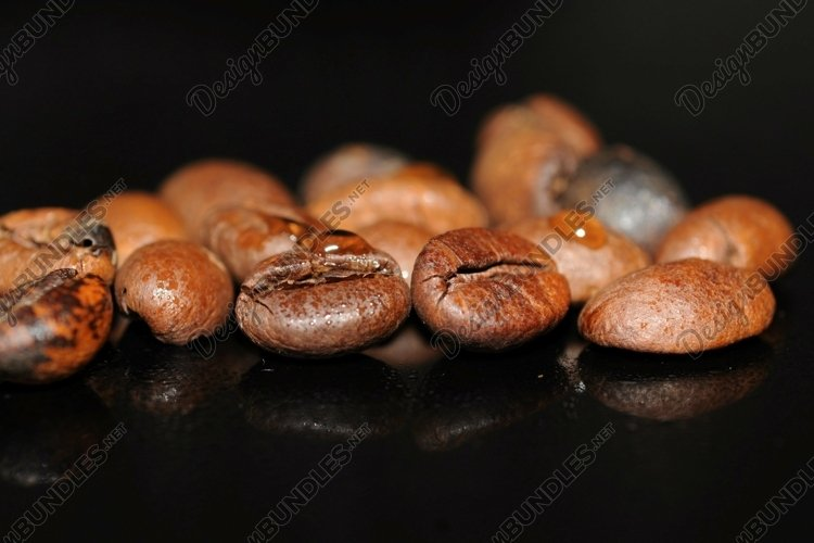 Coffee beans isolated on black background