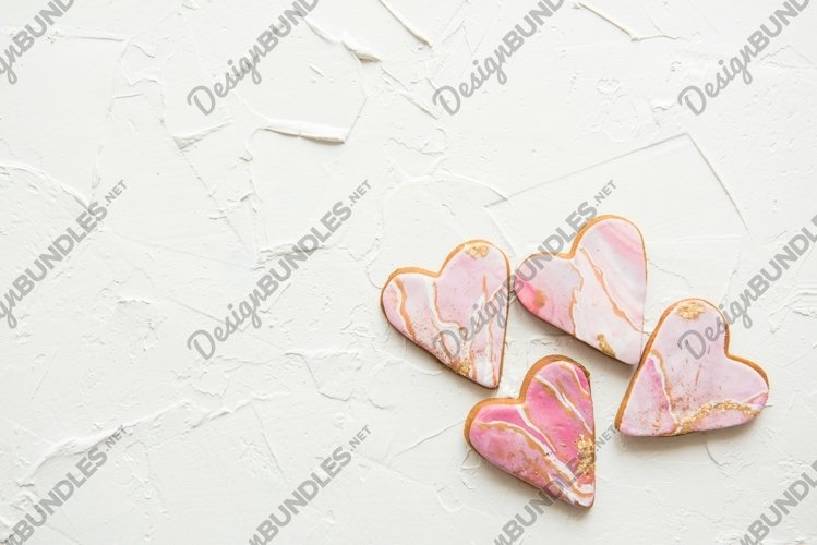 Four cookies in the shape of marble white hearts example image 1