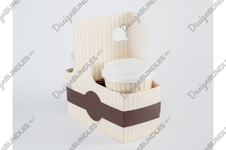 Paper cups with coffee in a takeaway box on a white example image 1