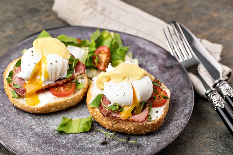 Eggs Benedict with salad on the plate example image 1