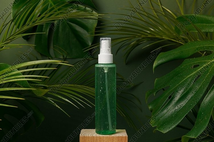 Cosmetic green bottle of skincare product with tonic