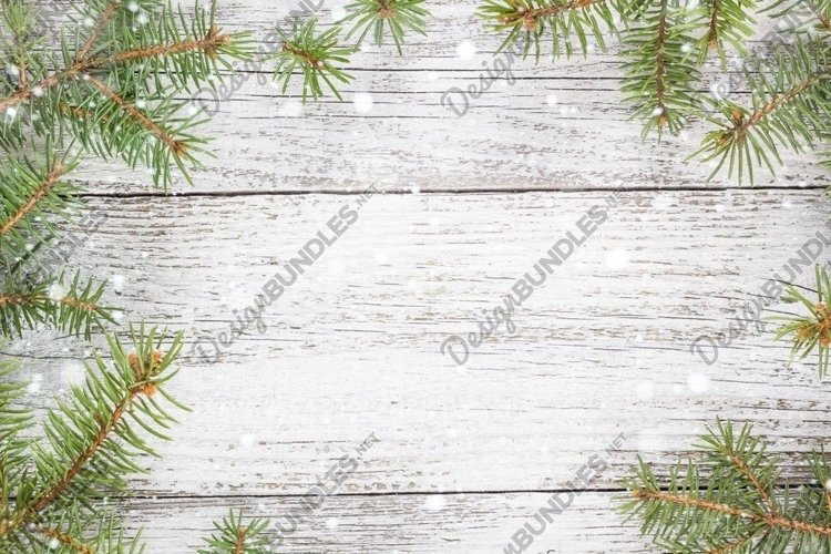 Christmas wooden background with snow fir tree example image 1