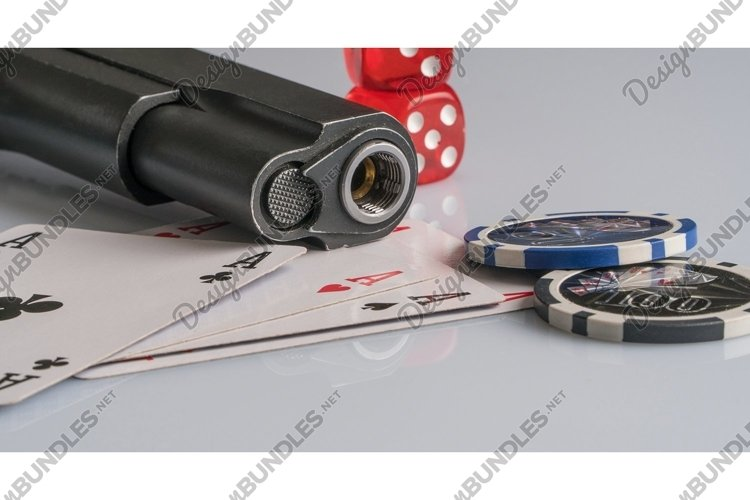 Poker chips, cards and gun on a white. Casino and poker example image 1