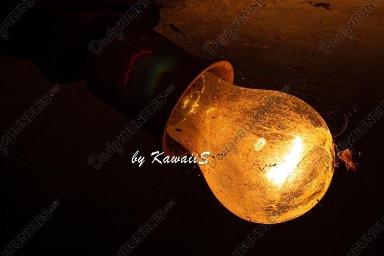Old bulb lamp glowing in the dark dusty vintage light Idea