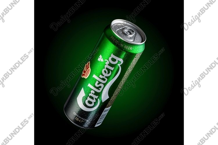 Can of beer Carlsberg with drops of water in a green example image 1