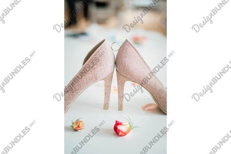 wedding ring between shoes example image 1