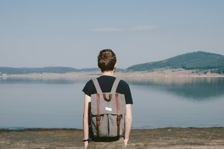 Hipster boy admires beautiful view example image 1