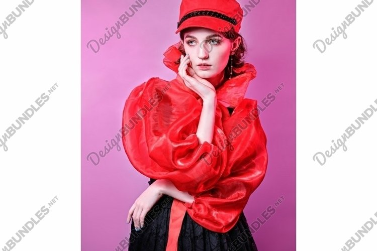 portrait of fashionable young girl in red hat black dress