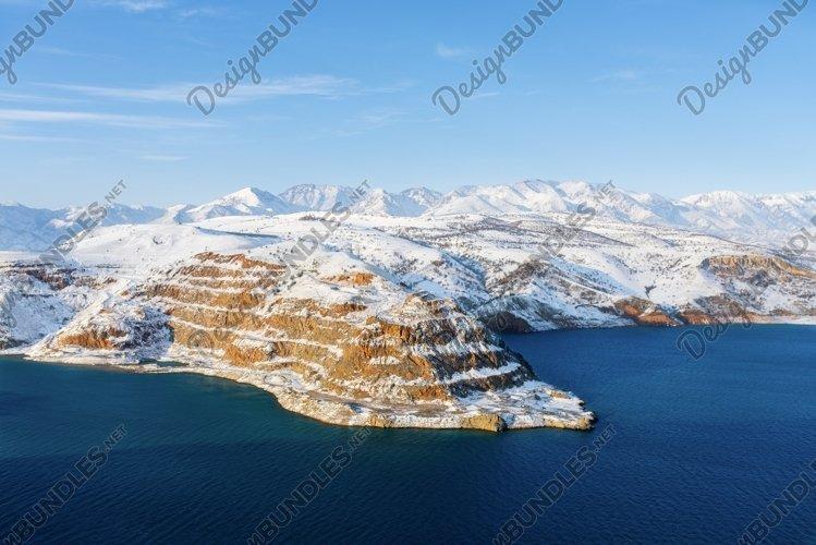Amazing winter landscape of Charvak reservoir in Uzbekistan example image 1