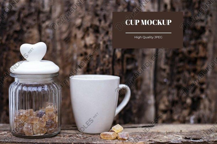 Sustainable mug mockup on wooden background
