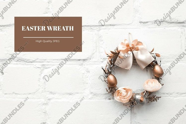 Easter card with sustainable wreath on bricked wall