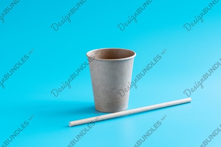 Recycled paper cup and drinking straw on blue background example image 1
