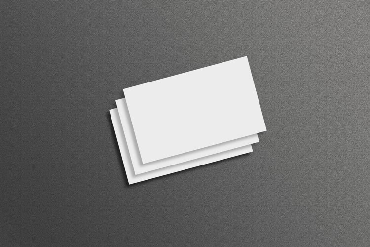 Business card mock ups on black wall background example image 1