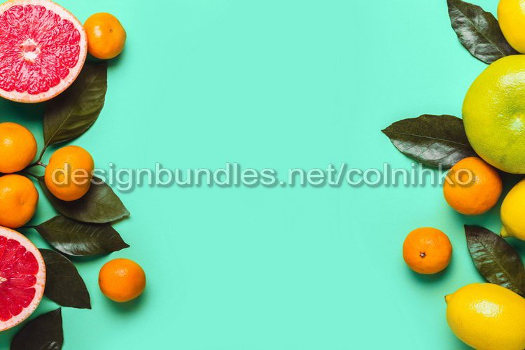 Mint Green background with different citrus fruits