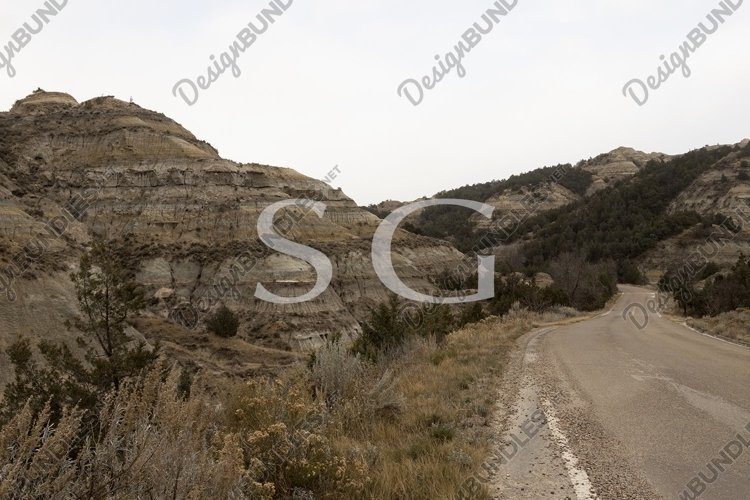 Mountain road through the badlands of Theodore Roosevelt Nat example image 1