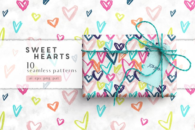 Candy and doodle hearts seamless patterns, vector