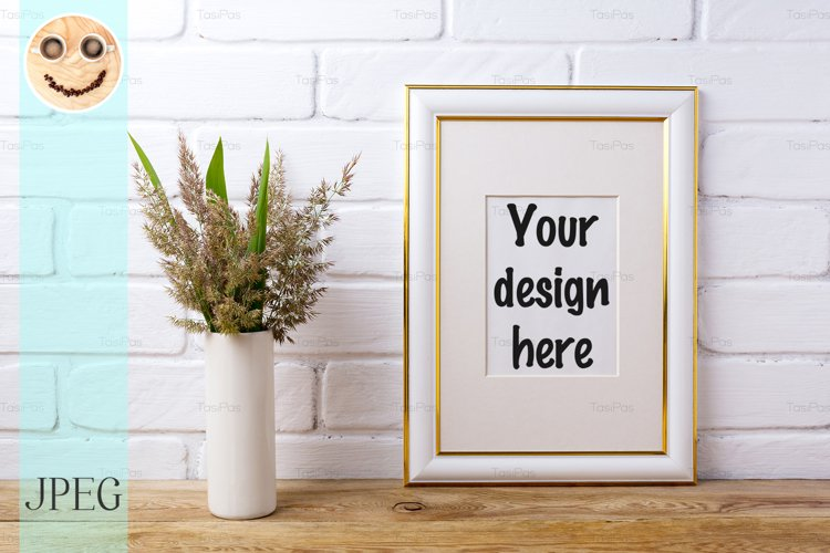 Gold decorated frame mockup with grass and green leaves example image 1