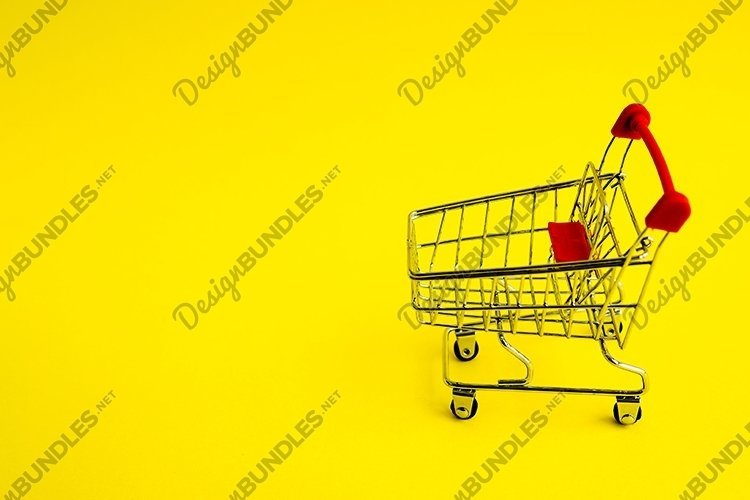 Shopping cart on yellow background example image 1