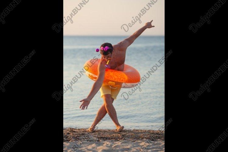 Fun dance at the seashore example image 1