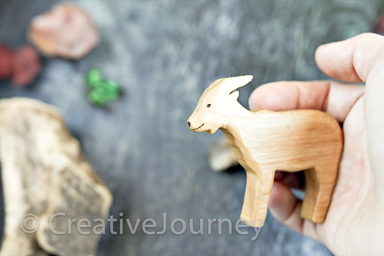 Wooden toys close up.Goat.