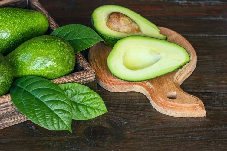 Fresh avocados. Background with avocado.
