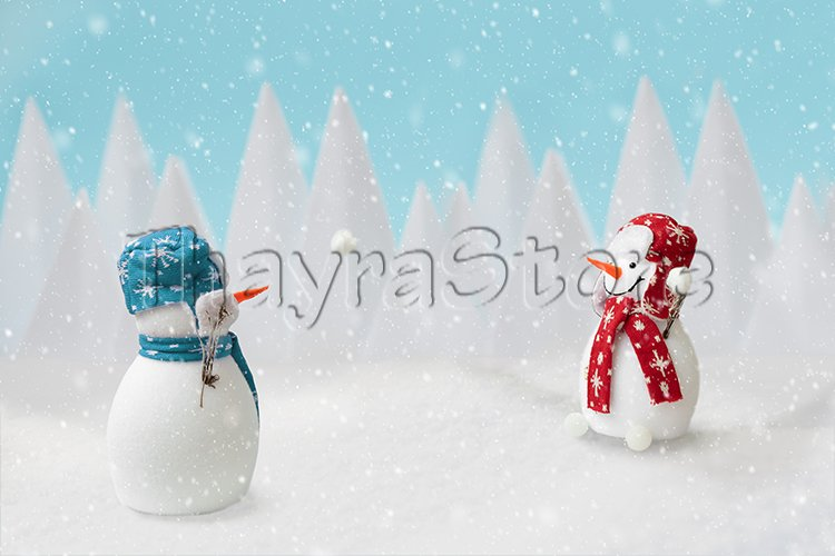 Happy snowmen playing snowballs in winter landscape example image 1