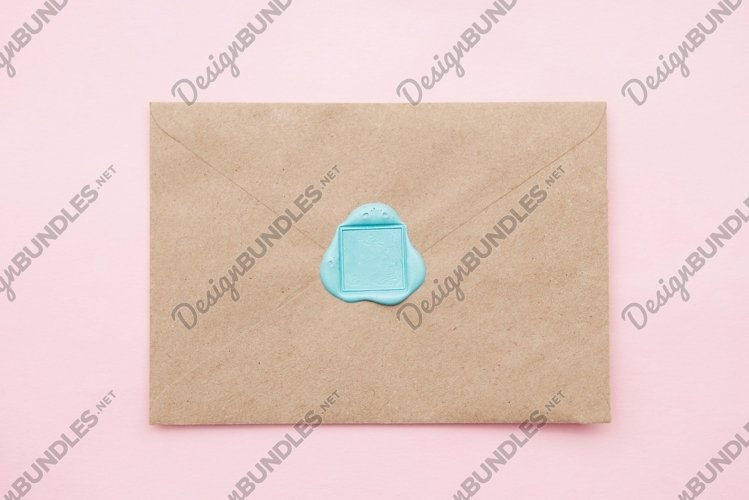 Old letter envelope with wax seal on pink background example image 1