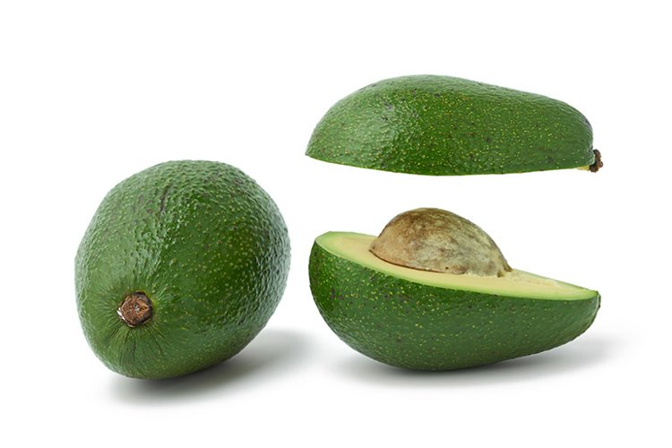 cut ripe green avocado with a bone example image 1