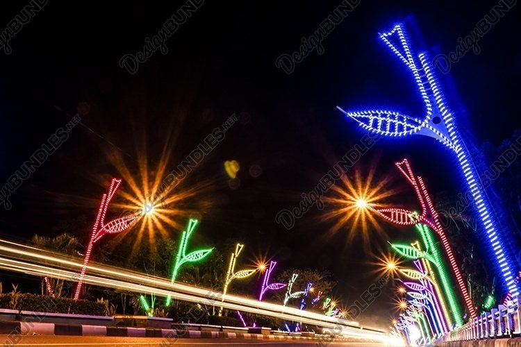 Long exposure of street at night with passing cars example image 1