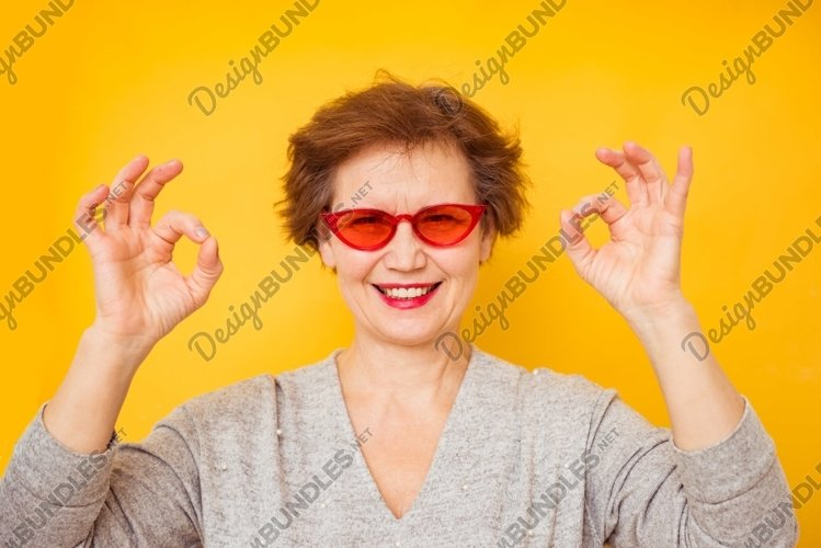 Older female feeling positive and enjoy concept example image 1