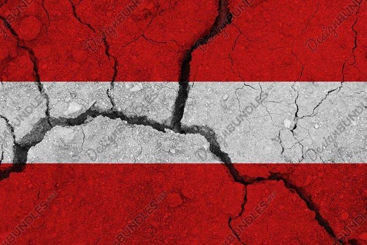 Austria flag on the cracked earth. National flag of Austria.