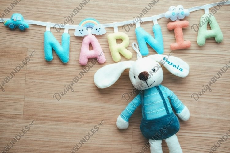 A rabbit doll hanging on the clothesline. example image 1