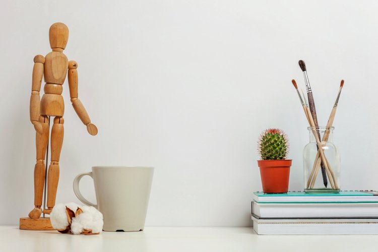 Home or office decor with mannequin coffee cup white wall example image 1