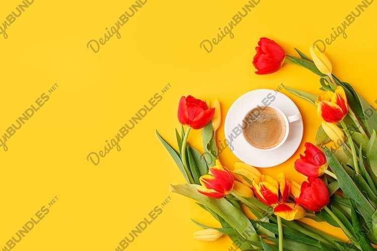 Coffee mug with bouquet of red yellow tulips and copy space