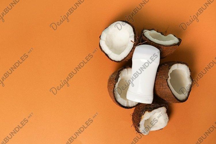 Antiperspirant deodorant with coconut on orange background