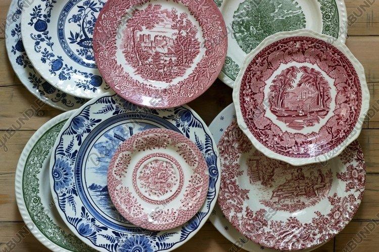 2 photographs of vintage porcelain plates. example image 1