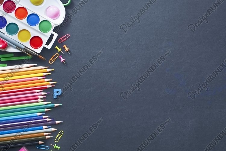 Blurred still Life of School office supplies on a table. example image 1