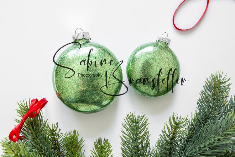 Styled Stock Photo Two Green Disk Ornaments Christmas Mockup example image 1