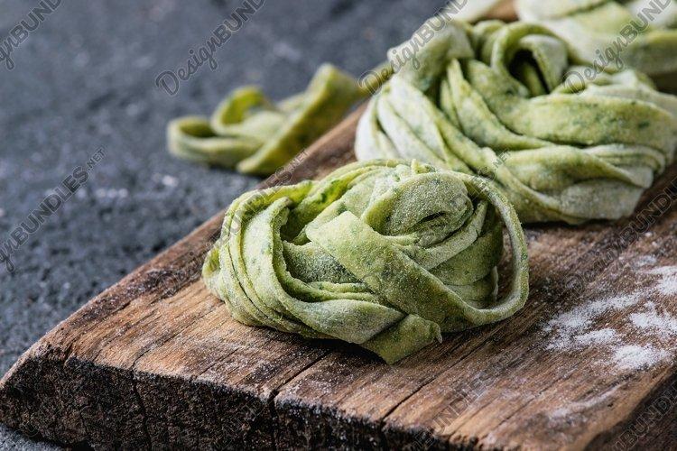 Fresh homemade green pasta tagliatelle example image 1